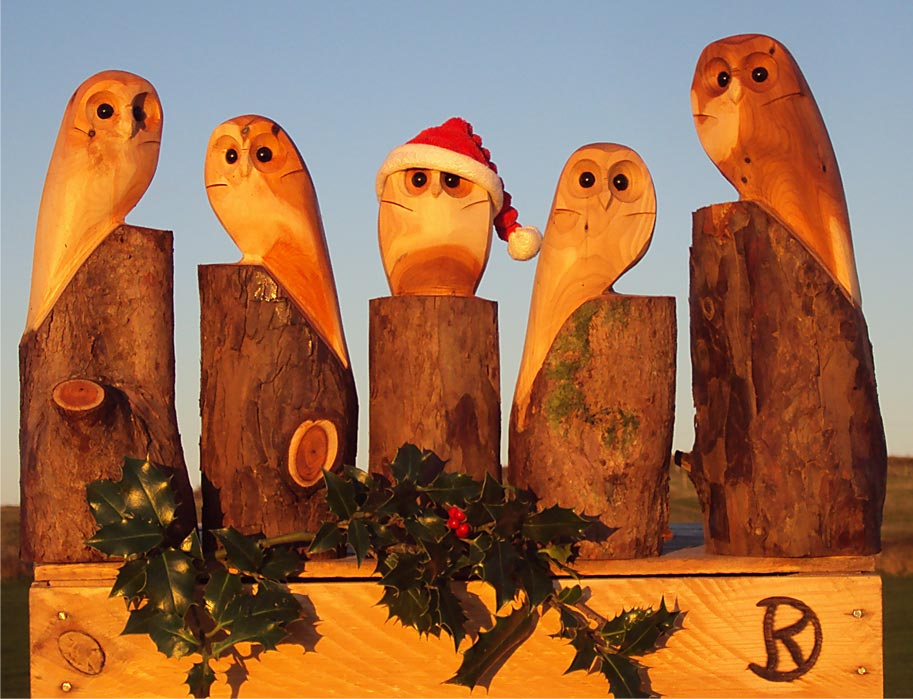 Yew owls wooden chainsaw sculptures by duncan kitson